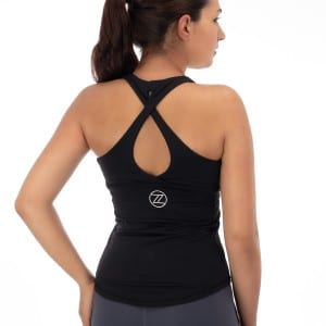 Model wearing ZZ sports top back and logo, showing clothing product photography.